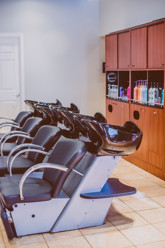 Experience a relaxing scalp massage in our shampoo area.
